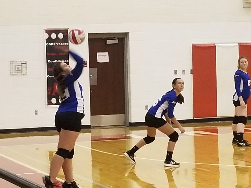 Emma Martin serves for the Lady Jets